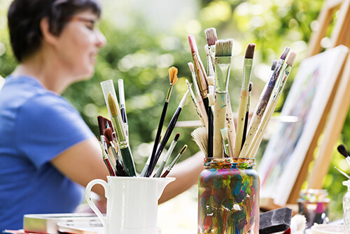 woman enjoys art therapy in garden