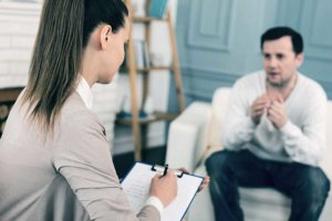 A counselor explains what happens at drug rehab centers to a potential patient