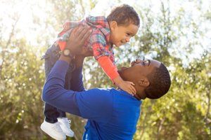 man plays with his son while doing outpatient alcohol rehab