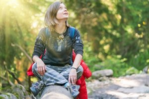 woman in the woods benefits from outpatient drug rehab