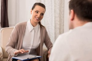 man talks to therapist about paying for rehab