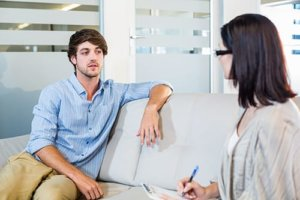 therapist talks to man about rehab facilities in the woodlands tx