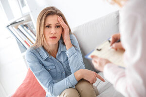 woman speaking with her behavioral therapist