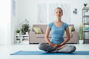 woman meditating for mindfulness based stress reduction